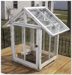 An urban homestead recycling project using windows. This small greenhouse could be a cute decorative feature, or quite functional, and could be sized to just about any dimension your reclaimed windows will allow.
