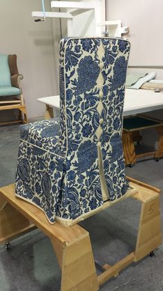 custom parsons chair slipcover with decorative back and banded skirt.