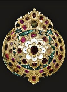 An Ottoman gem-set and enamelled belt buckle, Turkey, 17th century. Diameter: 76 mm.