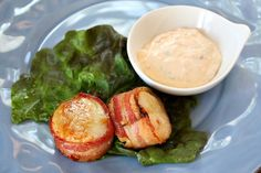 Bacon wrapped scallops with spicy-cilantro mayo.