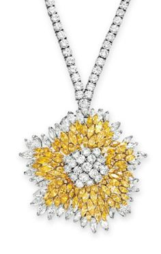 A COLORED DIAMOND AND DIAMOND PENDANT BROOCH, BY VAN CLEEF & ARPELS   Designed as a circular-cut diamond cluster, within a marquise-cut yellow diamond surround, trimmed with marquise-cut diamonds, mounted in gold and platinum, 1973, accompanied by an unsigned circular-cut diamond neckchain, 24¼ ins. (may be worn at various lengths)  Pendant brooch signed Van Cleef & Arpels, N.Y., no. 43793
