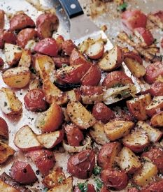 Mustard-Roasted Potatoes - 2.5 lbs. small red potatoes - yellow onions - good olive oil - whole grain mustard - kosher salt - fresh flat leaf parsley