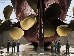Dockworkers examining RMS Titanic's triple screws as she lay in dry dock, Harland and Wolff Shipyards, Belfast, 1911 or 1912.