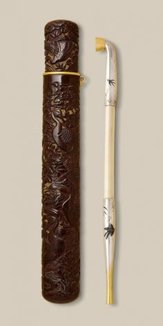 Finely carved lacquer kiseruzutsu (pipe case) with geese, flowers and swallows Signed Hokei