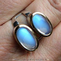 http://de.dawanda.com/product/90970895-ceylon-mondsteine-750-goldfassung-ring-925-silber