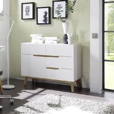 Merina Compact Sideboard In Matt White And Oak With 4 Drawers And 1 Door will make a perfect piece for smaller space providing sufficient storage Finish: Matt White And Oak Features: •Merina C...