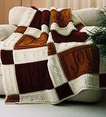 """This crocheted blanket is an original design that is easy to complete. The entire blanket requires only three crochet stitches - chain stitch, single crochet and the popcorn stitch. The pattern includes the instructions, a list of materials and the yarn amounts needed for a finished blanket approximately 41"""" x 58""""."""