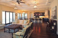 Cozy Brown Stools in the Open Kitchen Floor Plans with White Island and Wooden Cabinets under Bright Lamps