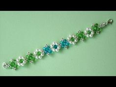 # DIY - Pulsera con rondeles azules y verdes # DIY - Bracelet with blue and green rondeles - YouTube