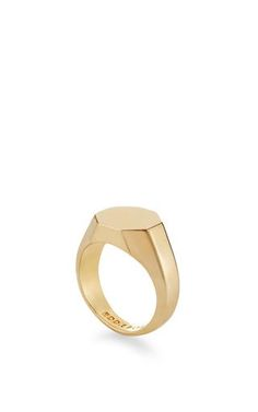 This **Eddie Borgo** octagon signet ring features a stunningly minimalist design rendered in shiny plated brass.