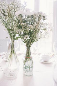 White Wedding Flowers in Bottles Fun Quirky 1950s Wedding http://www.petecranston.com/