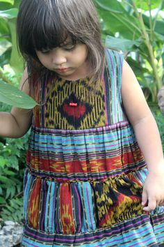 Beautiful Javanese textiles repurposed into lovely things like this little girl dress.