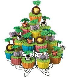 Throwing a Jungle or Safari Theme Baby Shower? Here you can find a few ideas to make your event fun and special. Jungle Theme Cupcakes, Jungle Theme Birthday, Animal Cupcakes, Jungle Party, Safari Party, Safari Theme, Themed Cupcakes, Jungle Safari, Jungle Animals