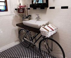 Looking at this charming bathroom with a creative twist, a bicycle sink. Would you ever use a bike and transform it into a bicycle sink in your bathroom? I think the black & white tile floor and b Bicycle Sink, Old Bicycle, Old Bikes, Bicycle Decor, Bicycle Basket, Bicycle Wheel, Tandem Bicycle, Cruiser Bicycle, Diy Casa