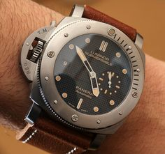 """Panerai Luminor Submersible Left-Handed Titanio PAM569 Watch Hands-On - Read more and see all the photos on aBlogtoWatch.com """"For 2014, Panerai quietly released a trio of watches with a sort of aged """"vintage look"""" and lefty-style crown orientation. The Panerai Luminor Submersible Left-Handed Titanio PAM569 watch was among them, and it is a hell of a watch for Panerai lovers..."""" #ablogtowatchSIHH2014"""