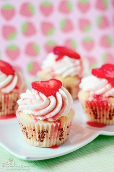 White Chocolate Strawberry Ice Cream Cupcake http://thecupcakedailyblog.com/white-chocolate-strawberry-ice-cream-cupcakes/