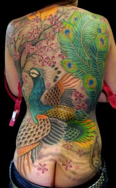 Colorful peacock back tattoo by Heidi Hay