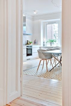 Hay chairs in a light and bright Swedish apartment