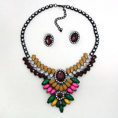 Do you wear your heart on your sleeve like a badge?  Decoration Day is not your typical necklace set.   Mod but vintage. Clear, solid color, and neon rhinestones all in one. A black metal setting makes it tough but the brooch style makes it ladylike.  How will you wear it?  Necklace is 18... #SweetSangria #jewelry #trending #eyecandy #unique #boho #accessories #fashion #coolmom #womensjewelry