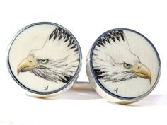 """Handmade sterling silver scrimshaw cufflinks. Handmade scrimshaw cufflinks by Jenkins with scrimshaw by David Adams on ancient mammoth ivory. We do not get many of these cufflinks anymore, but whenever we do they are always first rate. Size: 3/4"""" Diameter Price: $275.00 -- on ScrimshawGallery.com #cufflinks #jewelry #scrimshaw"""