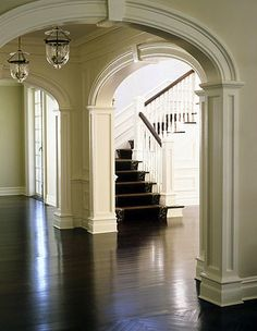 arched cased opening, hardwood floors.