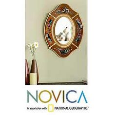 @Overstock - Sophisticate your home today with this reverse-painted glass butterfly wall mirror. Constructed with a wood frame for durability, this wall mirror features designs of flowers and butterflies accented with brown, blue, purple, and yellow.http://www.overstock.com/Worldstock-Fair-Trade/Reverse-painted-Glass-Autumn-Butterfly-Wall-Mirror-Peru/5724437/product.html?CID=214117 $129.99