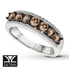 Breathtaking round Le Vian Chocolate Diamonds® are set in a band of 14K white gold in this alluring ring for her. Rows of round white diamonds above and below add brilliant contrast. The total diamond weight is 1 carat. Le Vian®. Discover the Legend.