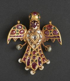A gem-set gold pendant in the form of a bird   probably Deccan or Southern India, 17th/ 18th Century