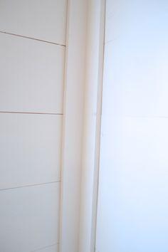 installing DIY shiplap walls and farmhouse trim from wood flooring