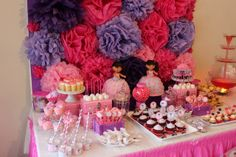 Great pom pom backdrop at a Dora the Explorer girl birthday. See more party ideas at CatchMyParty.com. #dora #girlbirthday