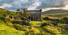 Farm house on Bodmin Moor, with Brown Willy in the background © Helen Hotson, Shutterstock