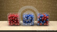 Electron,proton and neutron box in front of physics board with formul.