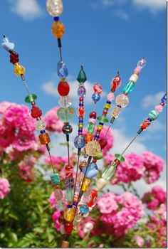 Garden Bead Art - for the Fairy Garden! I use stainless steel wire so that they don't rust. A great way and a pretty way to use beads of every type!