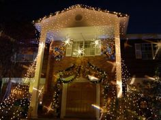 Theatrical Lights and Gorgeous Greenery-Great Ideas to Decorating a Joyful Christmas Entrance