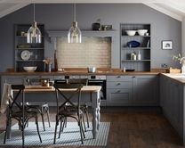 The Fairford Slate Grey kitchen has a dark grey Shaker style door with a wood grained detail. Create a uniquely stylish kitchen with colour-matched bespoke open shelving