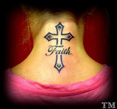 I LOOVE this tattoo<3<3 I'm gonna get something like this done soon..Ive always loved crosses for a tattoo. I'm definitely gonna get this before I start my half/sleeve <3