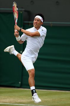 Kei Nishikori of Japan serves during his Gentlemen's Singles fourth round match against Milos Raonic of Canada on day eight of the Wimbledon Lawn Tennis Championships at the All England Lawn Tennis and Croquet Club on July 1, 2014 in London, England. (Photo by Clive Brunskill/Getty Images)