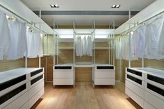 Walk-in master closet idea.  Don't like cabinets, but like light wood, size of room,  and hanging rods high enough off floor so that full-length dress can hang without folds.