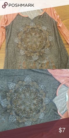 Maurices 3-quarter length tee brown shirt with orange sleeves. has bedazzled front. It's a longer shirt Maurices Tops Tees - Short Sleeve