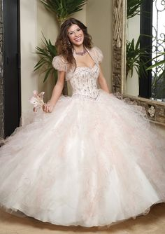 You'll be the belle of the ball in this beautiful light pink satin and beaded #quinceanera dress. #ballgown