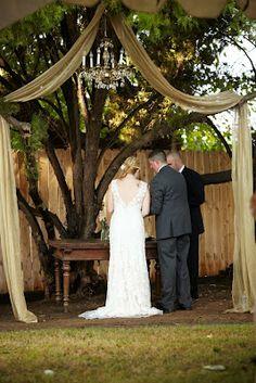 outdoor wedding ceremony underneath an elegant chandelier, #outdoor #wedding #decorations