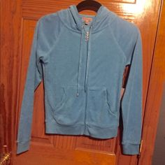 NWT Juicy Couture Terry Cloth Zipper Hoodie NWT Juicy Couture Terry Cloth Zipper Hoodie. Silver J on zipper, design on back with white sparkles, two pockets in the front, strings to tighten the hoodie. 80% Cotton 20% Polyester. Juicy Couture Tops Sweatshirts & Hoodies