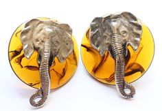 Vintage Tortoise Shell Lucite Round Elephant Earrings by paststore on Etsy