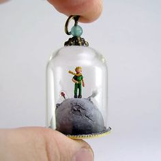 My name is Gregory Grozos and I specialize in making miniature worlds inside jewelry pieces. A few years ago I had the idea of making an entire tiny world which a person can carry on him or her. Miniature Bottles, Miniature Crafts, Clay Crafts, Arts And Crafts, Bottle Charms, Tiny World, The Little Prince, Mini Things, Glass Domes