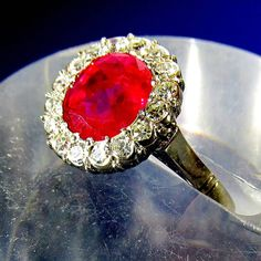 Fine Burma ruby diamond Platinum halo ring | From a unique collection of vintage cluster rings at https://www.1stdibs.com/jewelry/rings/cluster-rings/