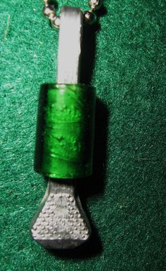 Lucky Horseshoe Nail Pendant with Green Glass by BulletsAntlersEtc, $15.00