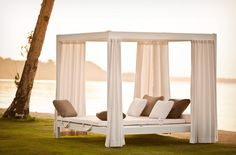 City Camp by Dedon. An outdoor bed. With curtains you can shut.