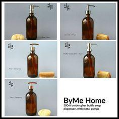 Amber glass bottle soap dispenser with metal pump and designer