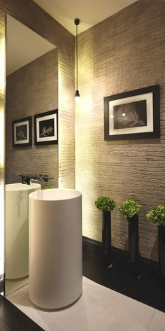 Love the textured walls, sink and sleek mirror desigin