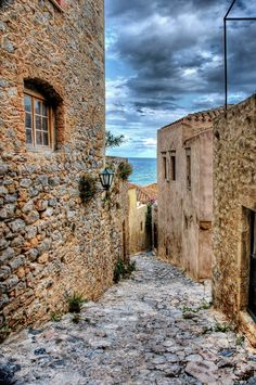 The most beautiful hidden city of the world is Greek. It is located on the slopes of a huge rock -- Monemvasia Greek Castle, Monemvasia Greece, Corinth Canal, Myconos, Earthship, Beautiful Places To Visit, Greece Travel, Greek Islands, Places To Go